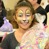 Girl with face painted at Good Friday Outreach.